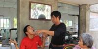 警察李国超创办残疾人之家十年 帮多名残疾人融入社会 - 海南新闻中心