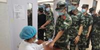 美兰区灵山镇为武警官兵开辟新冠疫苗加强针接种绿色通道 - 海南新闻中心